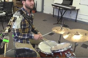 Third Arm Robot: Wearable Robot for Musicians