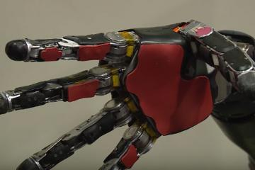DARPA Helps Paralyzed Man Feel Again with a Brain Controlled Robot