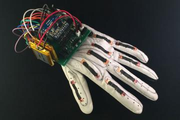 The Language of Glove: Smart Glove That Translates ASL