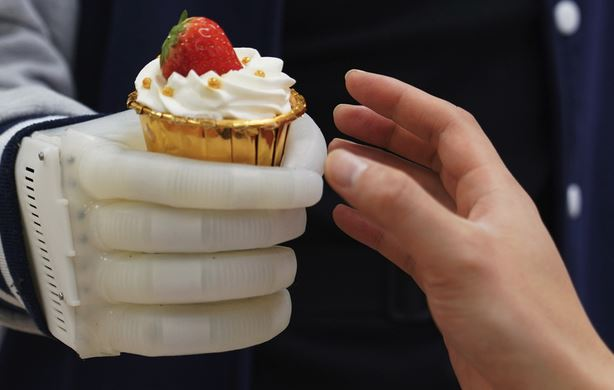 Inflatable Robotic Hand with Real-Time Tactile Control